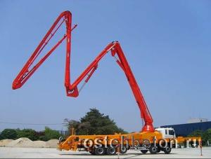 Доставка бетона с подачей транспортной лентой на высоту